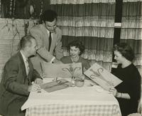 Unidentified woman dining at Jimmy Moran's Restaurant, 809 St. Louis Street, with unidentified couple