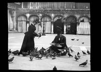 Feeding pigeons in a patio