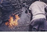 Man tending to the fire of a kiln