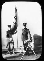 Soldiers with flag and a machine gun