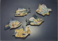 Collection of five blue-green fish sculptures