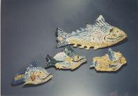 Collection of swimming blue fish sculptures