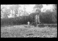 Man standing in front of ruins