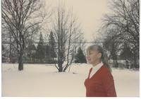 Woman in snowy yard 2