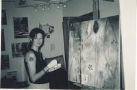 Woman working on large painting