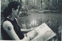 Woman painting near pond 2