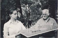 Woman and man working with small scale model 2