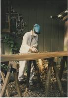 Woman cutting metal pieces outside