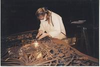 Woman working on gate design