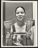 Woman holding wicker maracas