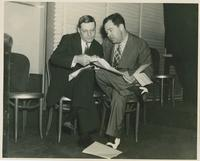 Huey Long Going Over Papers