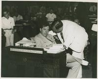 Huey Long at Charles Hudson's Desk