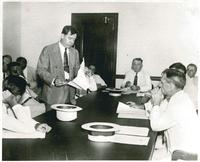 Huey Long Looking Over Papers