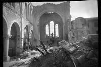 Bombed architecture, destroyed church with alter and Madonna standing