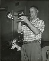 Ernie Cagnolatti playing the trumpet