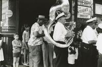 Red Clark Playing with Andrew Morgan's Brass Band playing on a corner