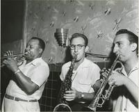 Three brass players playing at the Dixieland Lounge