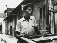 Percy Randolph standing outside his home