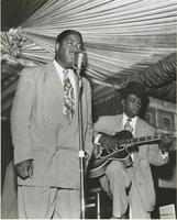 Two members of the Smilin' Joe Blues Trio playing during a nightclub performance