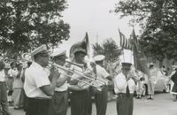 Young Tuxedo Brass Band members playing on memorial day