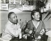 Lawrence 'Toca' Martin and Bille Pierce sitting in a night club in the 1600 block of N. Galvez