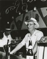 John T. Lala behind the bar at the Big 25