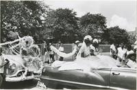 Girls on convertible float in the Jolly Bunch Parade
