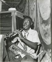 Israel Gorman playing the clarinet at a nightclub