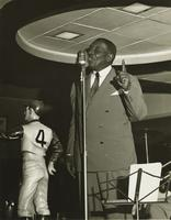 Oscar 'Papa' Celestin playing trumpet at the Paddock Lounge