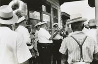 Andrew Morgan's Brass Band playing on a corner