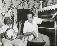 Two members of the Charlie Love band seated with instruments at rehearsal for Walter Eysselinck