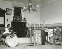 The Billie and DeDe Pierce Trio playing in a music hall