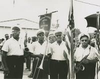 Young Tuxedo Brass Band members posing at the Merry-Go-Round parade