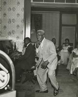Ernie Cagnolatti dancing to piano music played by Alton Purnell during a Musician's Union jam session
