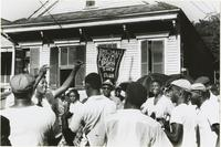 Jolly Bunch second line in front of a house