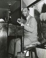 Octave Crosby playing paino with Oscar Celestin's band