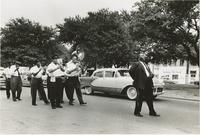 Young Tuxedo Brass Band marching in a funeral procession on N. Claiborne