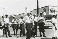 Young Tuxedo Brass Band playing in a Sunday School parade
