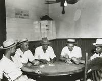 Men playing cards at The Big 25