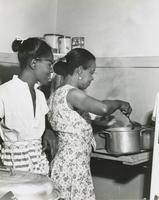 Women frying fish