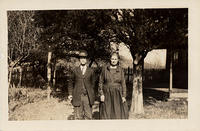 Rev M.N. Sumner and wife under trees at their home