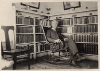 Rev. S. W. Pollard, Melstone, Montana with his books before the fire