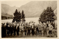 Assembly delegates on lake shore