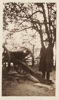 Unidentified man next to a cannon