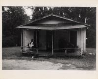 Child Sitting on Porch