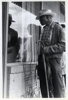 Man Looking in Window