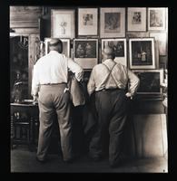 Unidentified-Group (two males examining art) 492