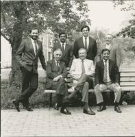 Civil engineering faculty around a bench