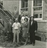 Group photo of faculty on stairs