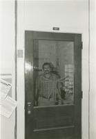 Nunez behind the door to the Department of Biomedical Engineering